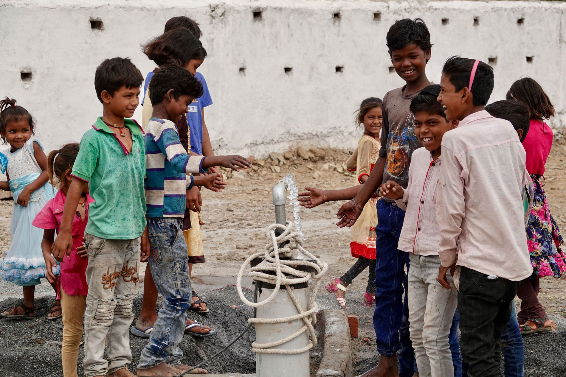 Children Celebrating New Well